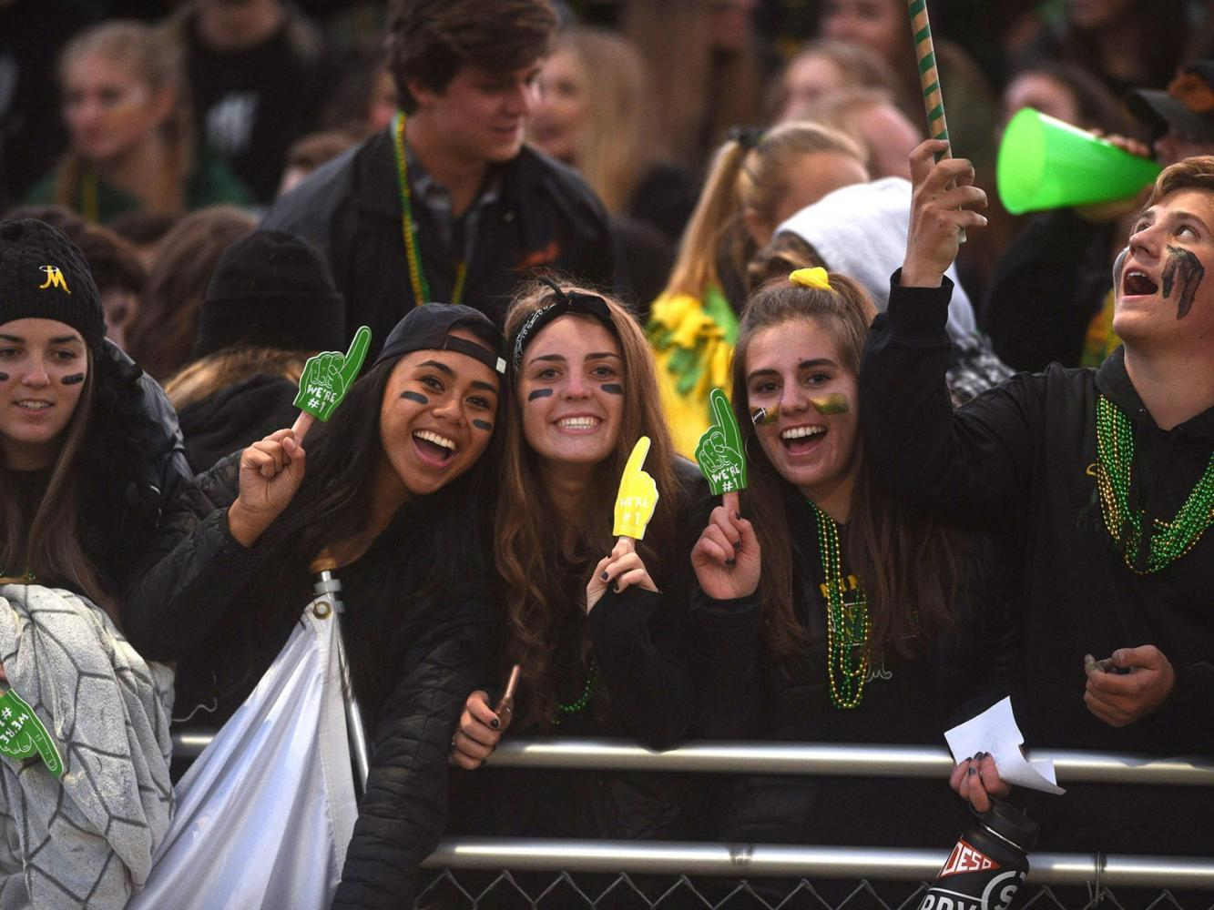 Manogue senior girls cheer on the football team during the September 22 game versus Reed.  Photo courtesy of the Reno-Gazette Journal.