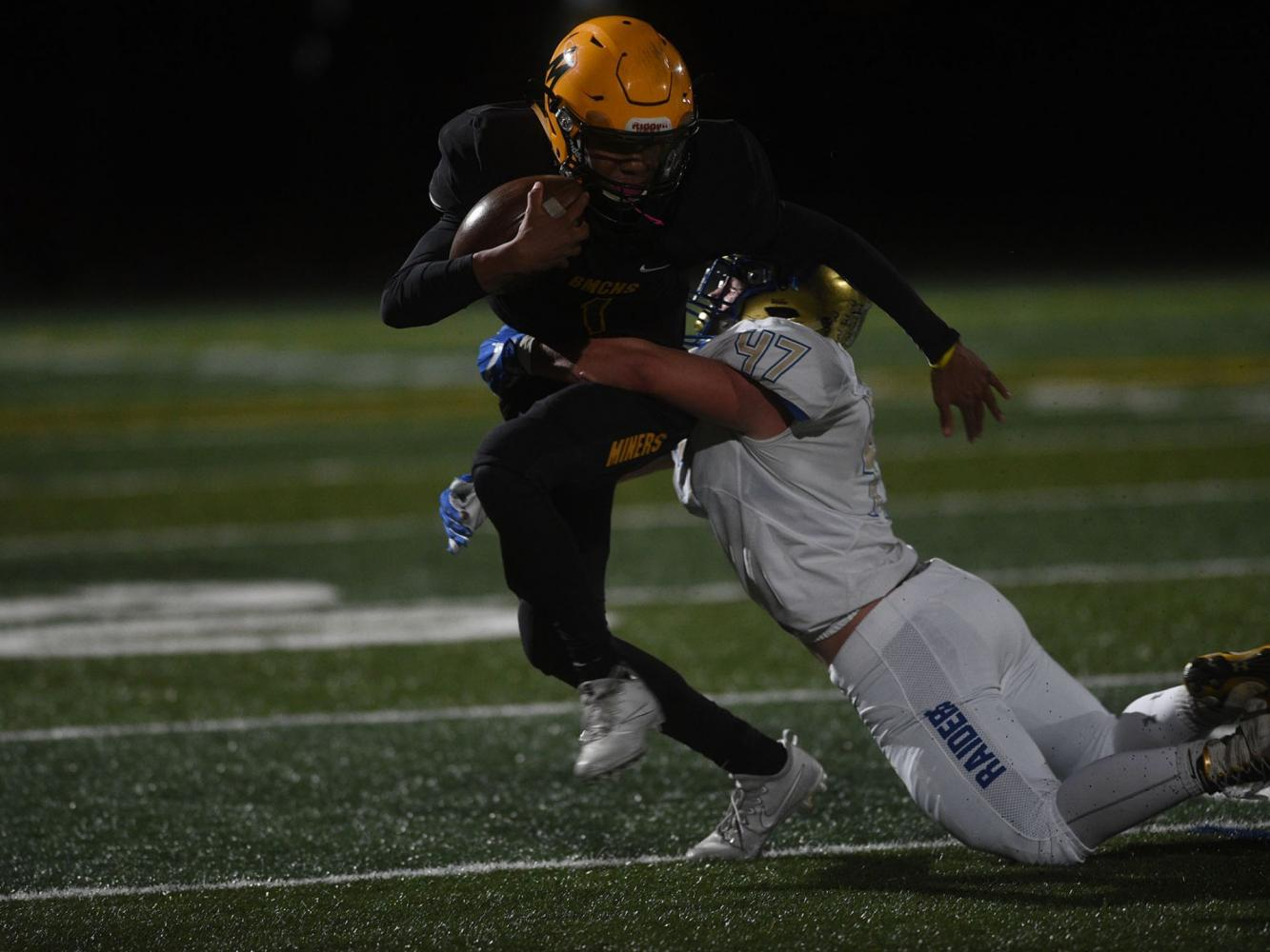 Josh Rolling makes a run for it, fighting back against the Reed Raiders on September 22. (Photo courtesy of the Reno Gazette-Journal)