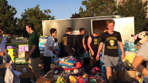 Students unloading donation items.
