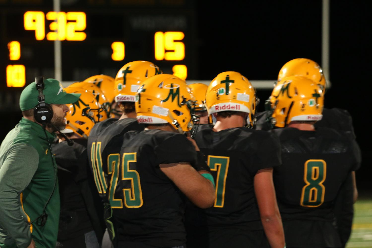 The Miner football team huddles during their September 22 game versus the Reed Raiders.  (Photo courtesy of Jackie Cavilia and the Bishop Manogue yearbook staff)