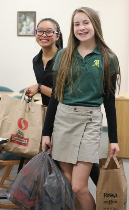 Sodality Members collecting donations for the Thanksgiving Food Drive. Photo courtesy of Jackie Cavilia and Bishop Manogue Yearbook Staff.