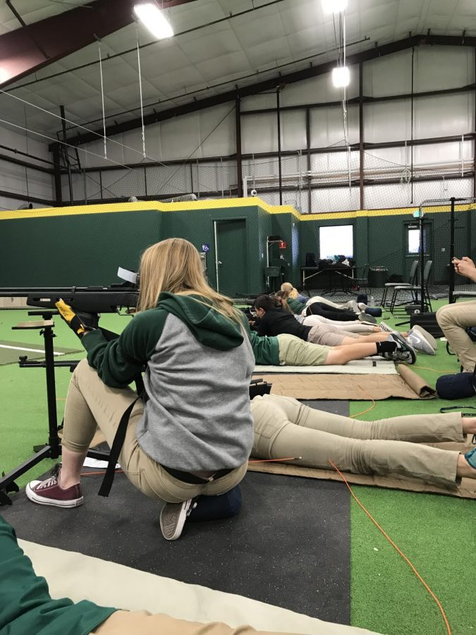 The Rifle Team practicing inside the Baseball and Softball facility. (Photo courtesy of BMCHS Journalism Staff)
