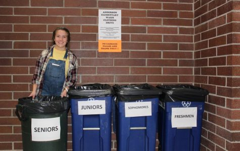 Valentina Ossio-Marin, President of the Interact Club, pictured next to the drop-off bins outside the Chapel. (Photo Courtesy of Miner Detail Staff)