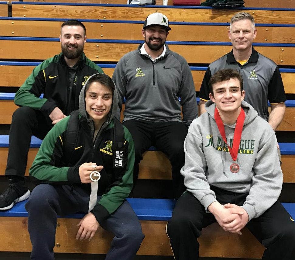 Anthony Rosas, Lincoln Hauck, and their coaches pose for a picture after the state tournament in Las Vegas on February 9.