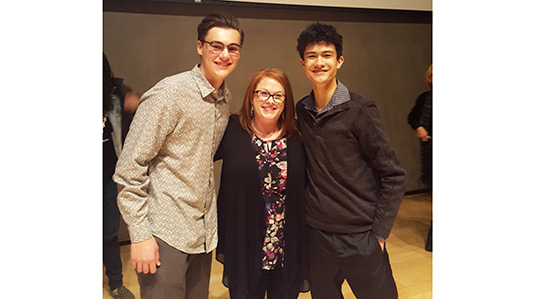 Tyler Rahimzadeh (left) and Mickey Kerr (right), with their Honors English 11 teacher Katie LaPointe (middle).