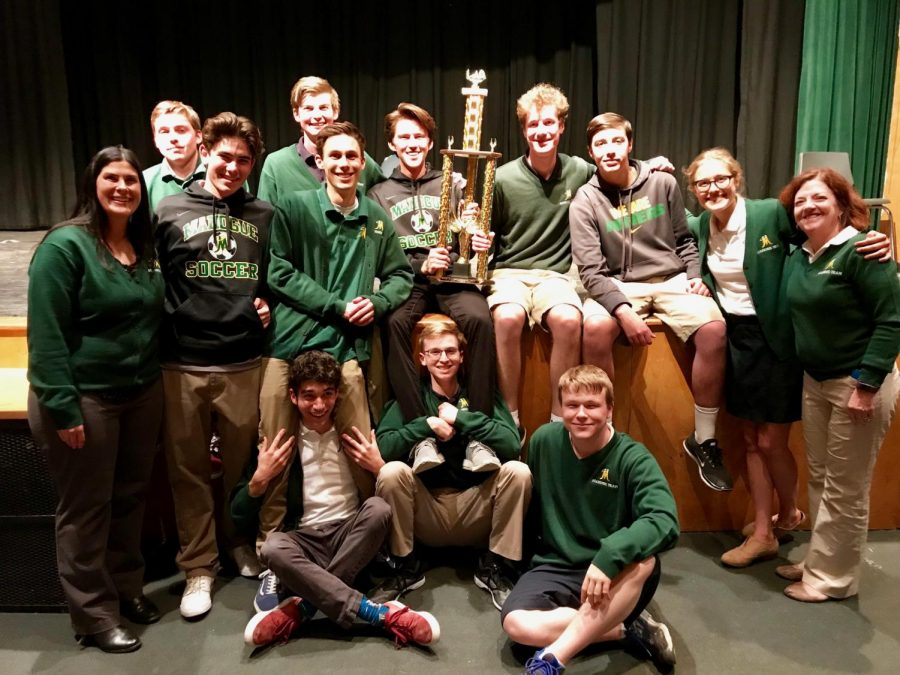 The Academic Olympic Champions pose with their trophy.