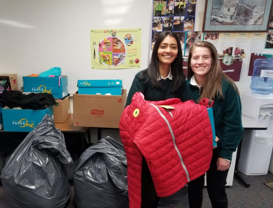 Jessica Parmar and Valentina Ossio-Marin show off a jacket to give away.