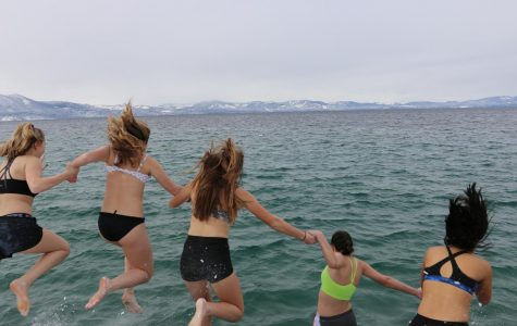 Kairos participants taking the leap into the cold Tahoe water. Photo courtesy of the Bishop Manogue Yearbook Staff.