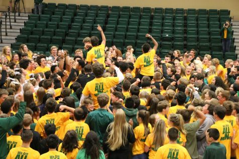 "Manogue students performing the ""I Believe"" cheer at the Homecoming rally. Photo courtesy of the Bishop Manogue Yearbook Staff."