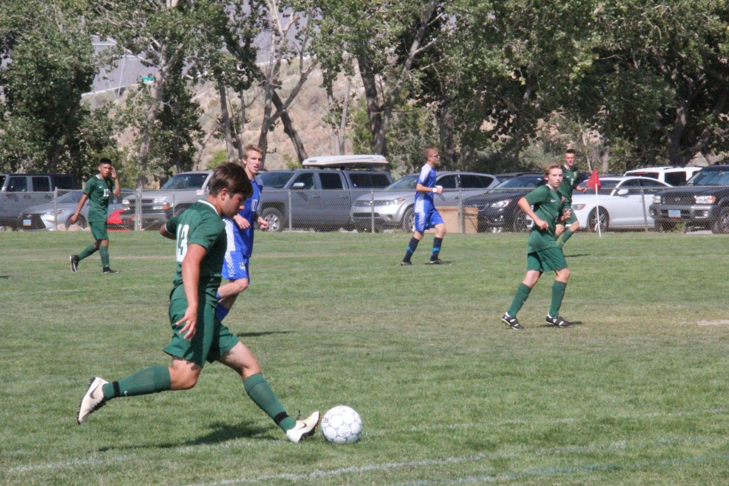 Captain, Benton Acosta, charges with the ball up the field. (Photo courtesy of the Bishop Manogue Yearbook Staff and Jackie Cavilia.)