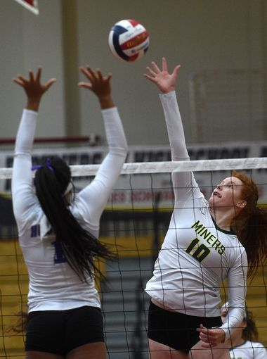 Senior Emma Pence (middle blocker) goes up for a swing during last year's Reno match.  (Photo courtesy of RGJ.)