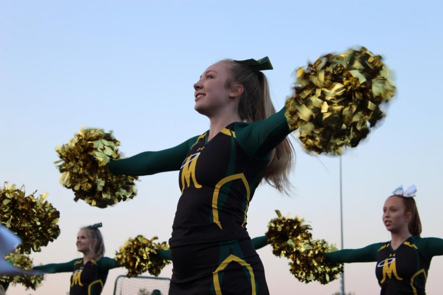 Hannah Shultz, captain, cheering on the Miner Nation at a football game. Photo courtesy of Brynn Sedar.