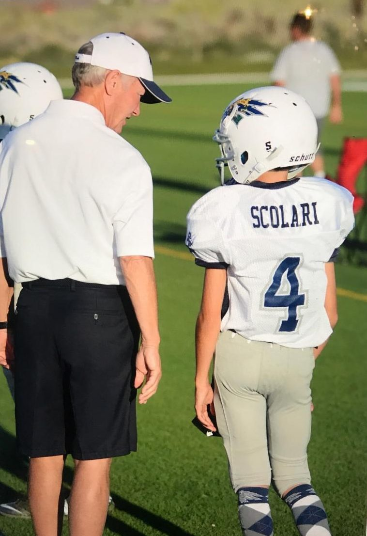 Scolari strategizing with his grandpa as a young football player. Photo courtesy of Drew Scolari.