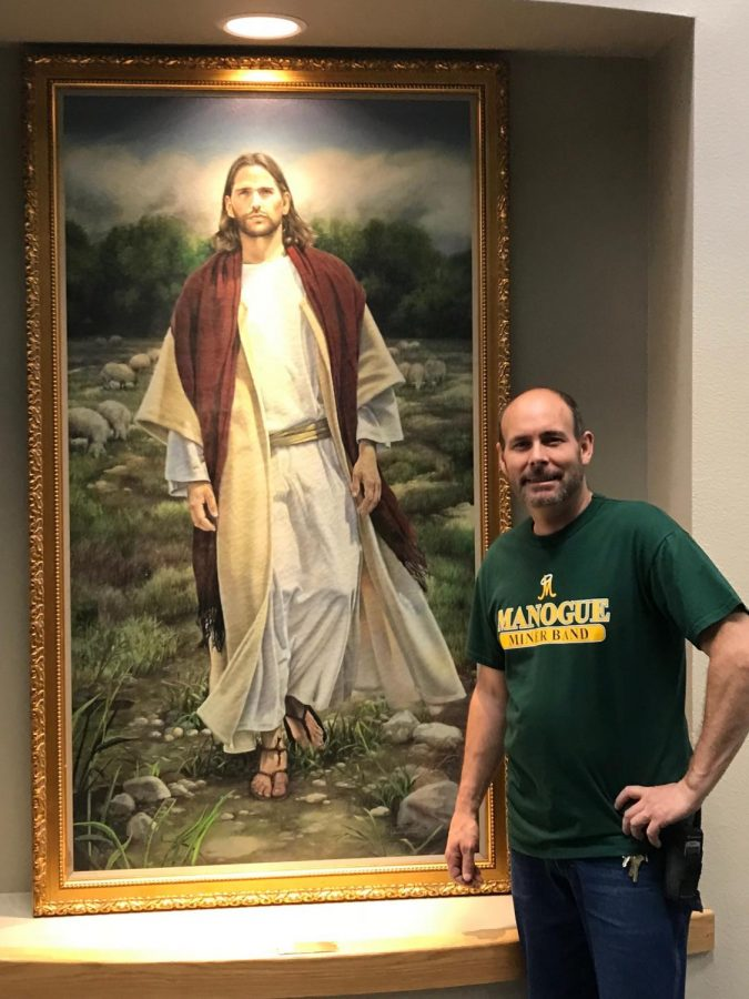 Brian Gurczynski poses for a picture next to Jesus.