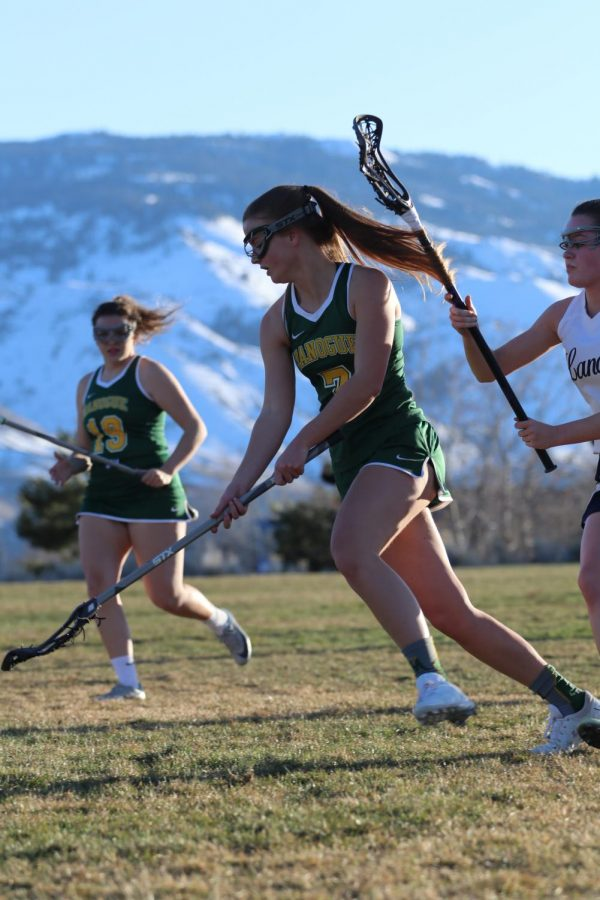 Mariclaire Geil runs down the field.  Photo courtesy of the Bishop Manogue yearbook staff.