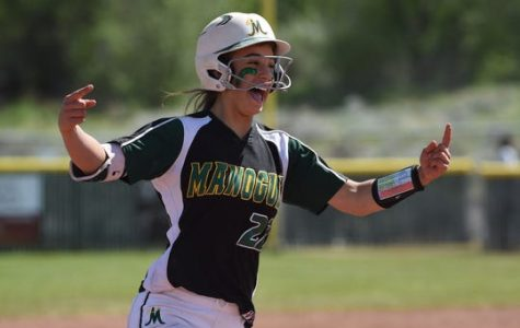 Senior Chelie Senini celebrates as she runs in toward home plate.  Photo courtesy of the Reno-Gazette Journal.