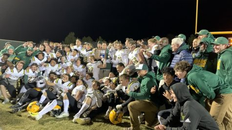 The 2019 varsity football team poses together after winning the regional championship last year. Photo courtesy of Nevada Sports Net.