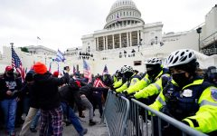 Trump supporters try to break through a police barrier, Wednesday, Jan. 6, 2021, at the Capitol in Washington. As Congress prepares to affirm President-elect Joe Bidens victory, thousands of people have gathered to show their support for President Donald Trump and his claims of election fraud. (AP Photo/Julio Cortez)