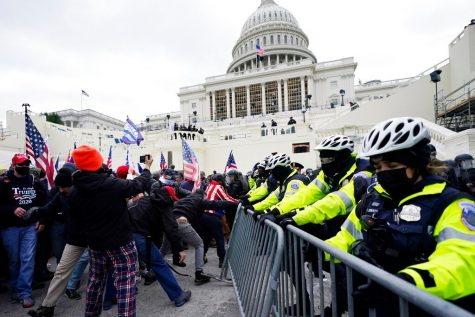 Trump supporters try to break through a police barrier, Wednesday, Jan. 6, 2021, at the Capitol in Washington. As Congress prepares to affirm President-elect Joe Biden